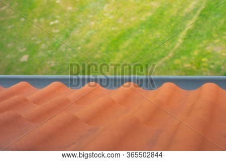 Roof Tiles And Gutter View From Above From The Roof. Brown Roof Tiles. Rain Gutter On The Roof And V