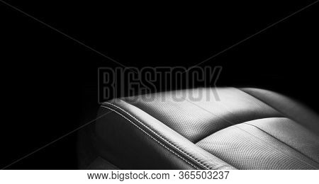 Luxury Car Black Leather Interior. Part Of Leather Car Seat Details With Stitching. Interior Of A Mo