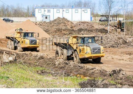 Kirishi, Russia - 8 May, Heavy Dump Trucks On Earthwork, 8 May, 2020. Start Of Construction Of A Mot