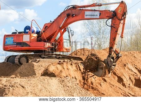 Kirishi, Russia - 8 May, Excavator With Sand In The Bucket, 8 May, 2020. Start Of Construction Of A