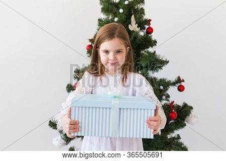 Holidays, Presents, Christmas, X-mas Concept - Happy Child Girl With Gift Box.