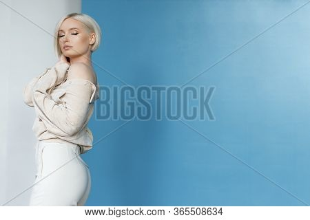 Stylish Woman.hot Blond Girl.perfect Make Up For Blue Eyes.copy Space For Text.woman With Short Hair