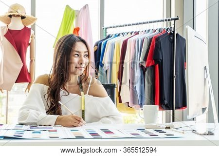 Asian Woman Designer Are Thinking And Drawing Something On Paper For Customers Order Items At The De
