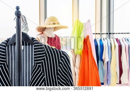 Fashion Creative Clothes Design Studio Concept. Women Dresses New Collection Of Stylish Clothes Wear