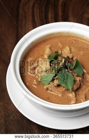 Thai Spicy Panang Pork Curry With Coconut Milk On Wood Table In Phuket Thailand