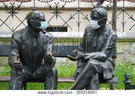 Otto Nikodym And Stefan Banach Are Sitting In Medical Masks On The Memorial Bench Quarantine Coronav