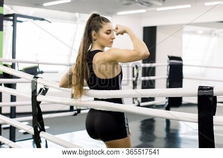 Young Pretty Boxer Woman Standing On Ring. Full Body Portrait Of Boxer Woman With Long Dark Hair Pul