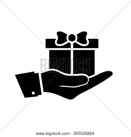 A Silhouette Icon From The Hand That Gives A Donation In The Form Of A Gift Box. Suitable For Design