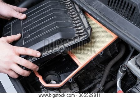 Caucasian Man Assembilng Air Box With New Filter In Car Engine Bay. Mechanic Repair Or Vehicle Maint