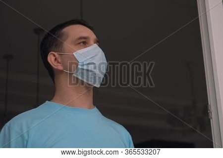 Home Quarantine, Self-isolation Because Of The Coronavirus Disease, Covid-19. Man In A Medical Mask