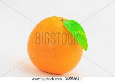 Fresh Orange Fruit With Leaf On White Background