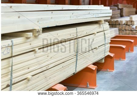 Many Wooden Planks In Hardware Store. Stacks Of Wooden Planks At Building Materials Store. Boards In
