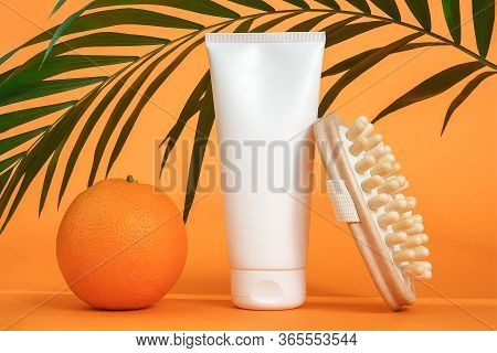 White Blank Cosmetic Tube Of Cream Or Body Lotion, Orange Fruit, Wooden Anti-cellulite Massager And
