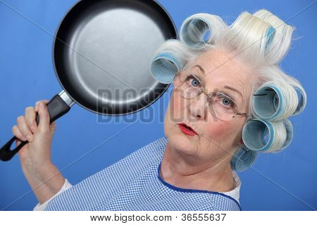 Elderly lady attacking with frying pan