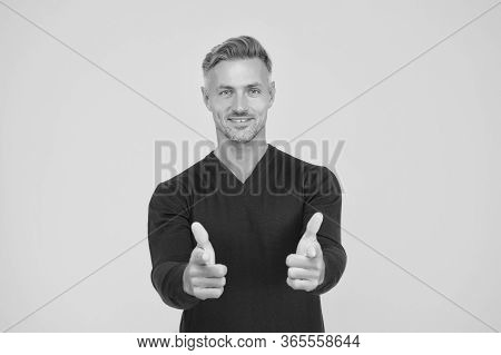 Only You. Handsome Guy Pointing Yellow Background. Happy Man Pointing Fingers. Pointing Hand Gesture