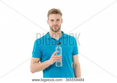 Required Amount Of Minerals And Salts. Stay Hydrated. Man Athletic Sportsman Hold Bottle Water. Heal