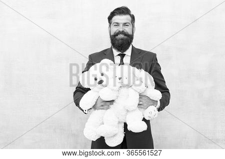 Lets Play All Day. Happy Businessman Play With Soft Toys. Childhood Play. Playing Games. Toy Shop. G