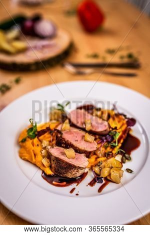 Grilled Pork Tenderloin And Pumpkin Puree On White Pate
