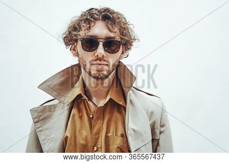 Cool And Handsome Young Adult Male Model Posing For A Photoshoot On A White Background In A Bright S