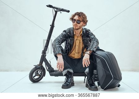 Stylish And Self-assured, Young Male Model Posing In A Studio For The Photoshoot Wearing Fashionable
