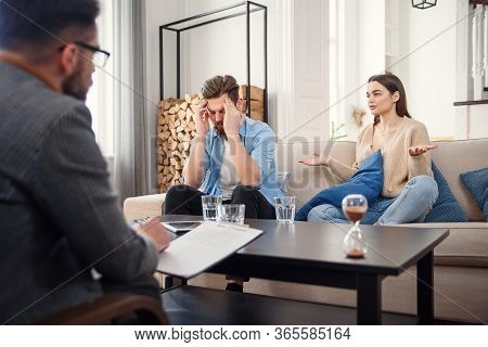Unhappy Couple Arguing, Having Fight, Disagreement At Psychologists Office, Frustrated Young Family