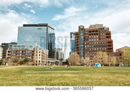 Denver, Colorado - May 1st, 2020:  View Of Commons Park With Apartments And Office Buildings In The