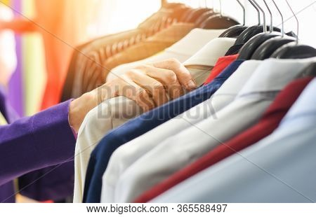Men Fashion Clothes / Hanging Clothes Suit Colorful Or Closet Rack Different Coloured Man Suits In A