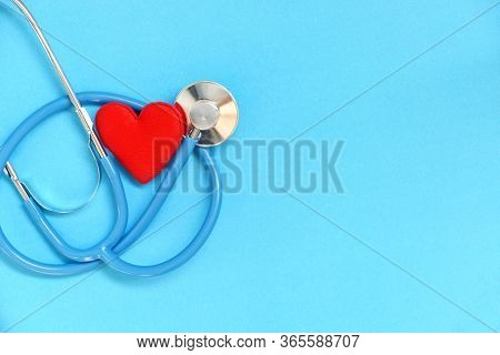 Heart Health And Red Heart With Stethoscope On Blue Background / World Heart Day World Health Day Or