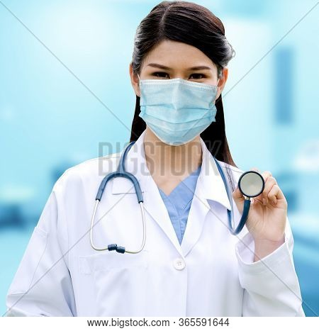 Doctor Wear Face Mask In Hospital Protect From Coronavirus Disease Or Covid-19.