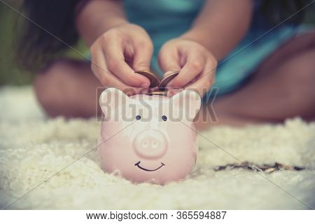 Adorable Kids Saving Coins In Piggy Bank. Happy Little Investment Saving Money For Happiness Future.