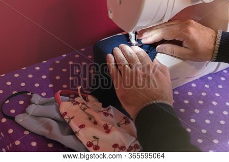 Hands Of A Man Using A Sewing Machine Making A Homemade Custom Mask For Prevent Coronavirus Disease