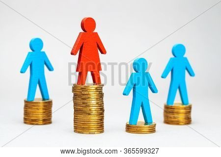 Discrimination Of Men At Work. The Salary Of Women Is Higher Than That Of Men. Stack Of Moent And Fi