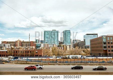 Denver, Colorado - May 1st, 2020:  Downtown Denver Skyline Overlooking Highway I-25