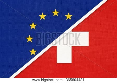 European Union Or Eu Vs Switzerland Or Swiss Confederation, National Flag From Textile. Symbol Of Th