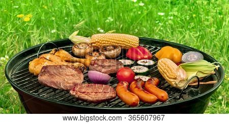 Barbecue Cookout. Grilled Meat, Sausages, Chicken, Vegetables, A Panorama With Green Grass In The Ba
