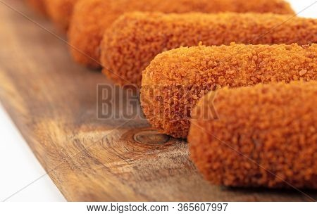 Brown Crusty Dutch Kroketten On A Serving Tray, Selective Focus, Isolated
