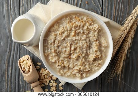 Composition With Oatmeal Porridge On Wooden Background. Cooking Breakfast