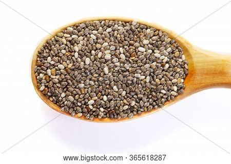 Black Chia Seeds In A Wooden Spoon Close-up. Macrophotography Of Chia. Health Food. Good Nutrition.