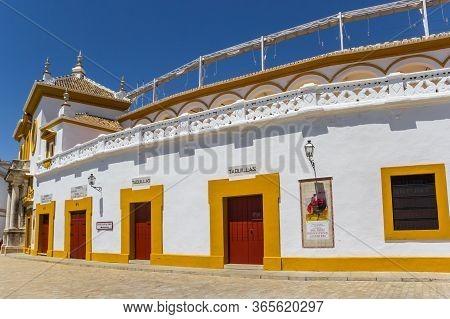 Sevilla, Spain - May 14, 2019: Red And Yellow Doors At The Bull Ring Of Sevilla, Spain