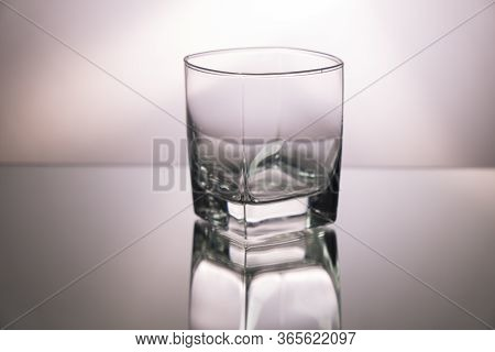 Glass Of Whiskey On Mirroring Table. Gorizontal Image With Copy Space.