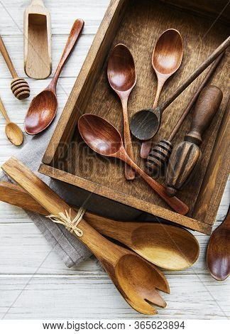 Top View On A Wooden Cutlery Kitchen  Ware In Old Wooden Box.  Flat Lay