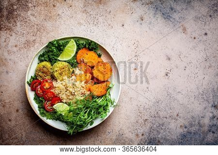 Vegan Dinner. Quinoa Salad With Baked Sweet Potato, Falafel, Kale And Pea Seedlings. Healthy Vegetar