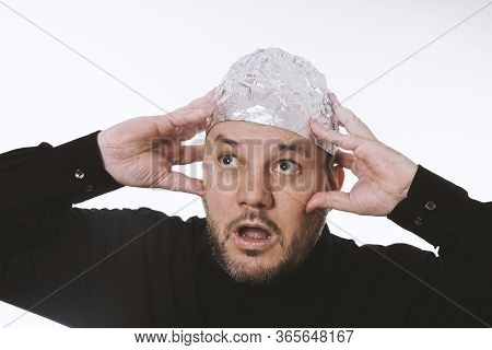 Paranoid Man Wearing Tin Foil Hat As Protection Against Mind Control And Electromagnetic Fields - Co