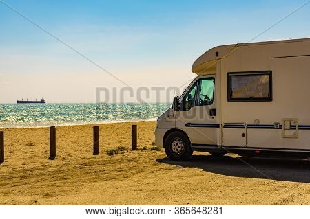 Camper Car On Quitapellejos Beach, Andalucia Region In Spain. Traveling And Adventure In Motor Home.