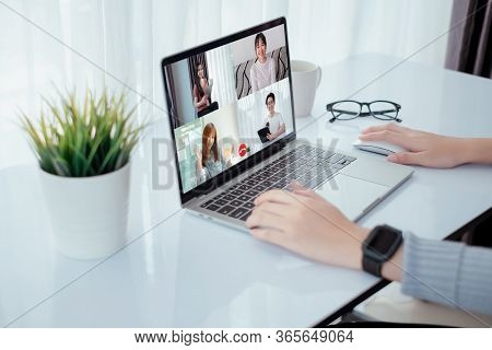 Asian Group Video Conference User Interface On Laptop Computer Online Remotely Working From Home Soc