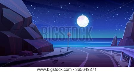 Mountain Road With Night Seaview, Empty Asphalt Highway Under Full Moon Glow In Starry Sky At Summer