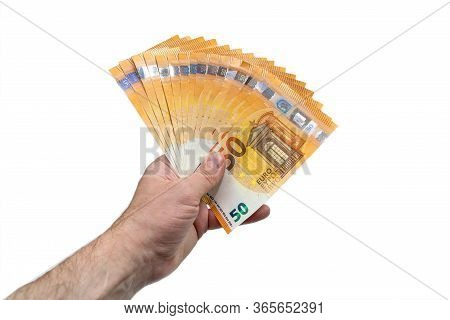 A Fan Of 50 Fifty Euros. The Hand Of A European Man Holds A Fan Of European Money. Isolated White Ba