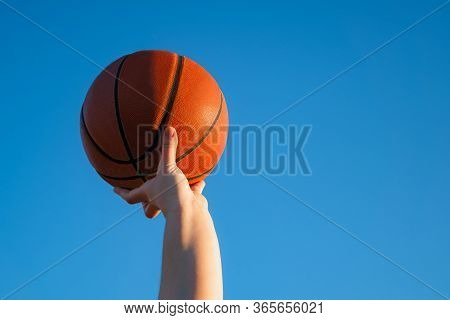 Close Up Of Professional Basketball Player Holding A Ball In The Hand. Street Basketball Athlete Wit
