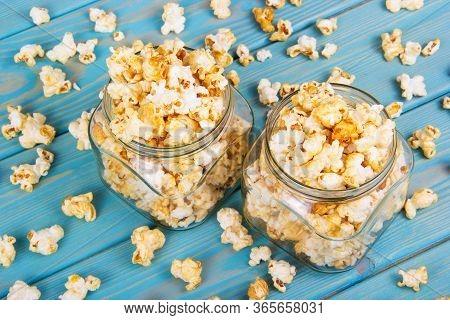 Sprinkled Sweet Caramel Popcorn. Popcorn In Glass Jars. Delicious Crispy Flavored Popcorn