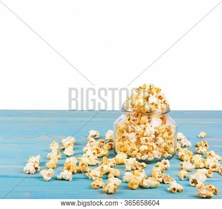 Delicious Caramel Popcorn On The Table. Golden Popcorn On White Background. Homemade Popcorn In Jar.